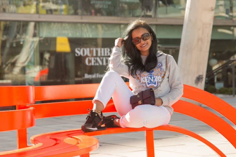 location portrait photography of girl on bench on southbank london by professional portrait photographer london Martin Lea